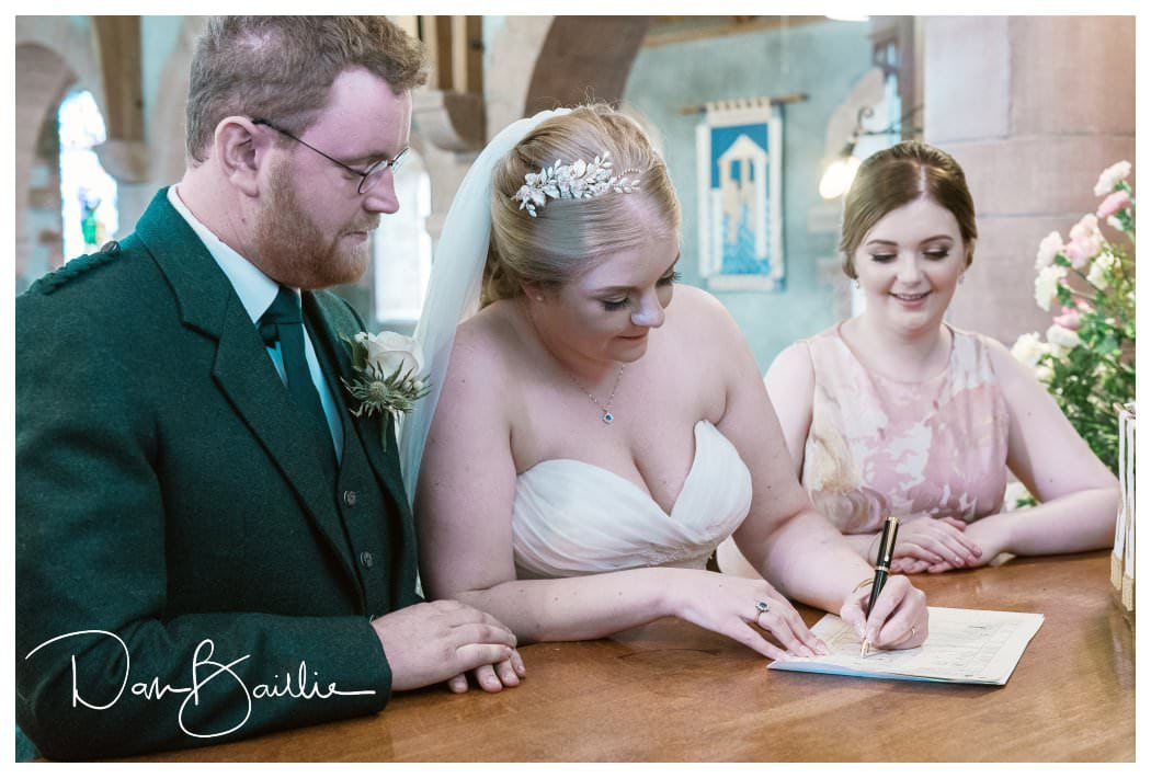 Signing the marriage register at Colvend Church