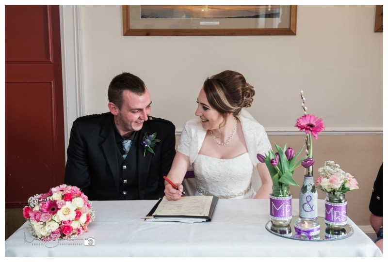 Sigining the wedding register