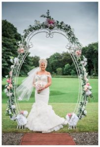 wedding flowers in a flower arch