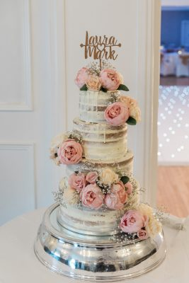 tiered wedding cake with frosted flowers