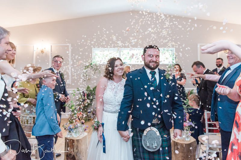 bride and groom are married showered with confetti
