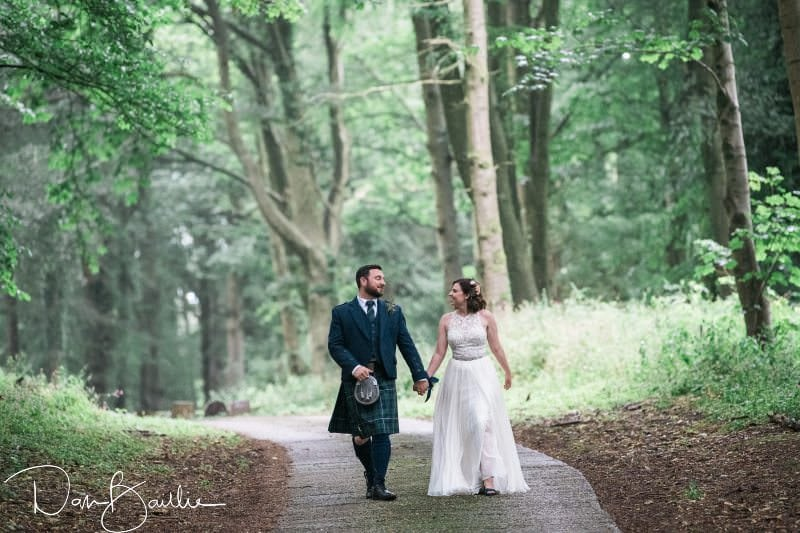 bride and groom walking at machermore castle