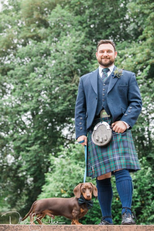groom and sausage dog at machermore castle